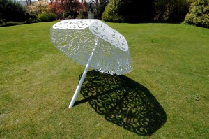 "Picture by Roger Bamber:25 April 2006: Sculptor Bruce Williams' steel canopy ""Parasol"" in the garden of the National Trust's Polesden Lacey near Dorking, Surrey. The sculpture is one of 10 works by 10 artists commissioned by Surrey County Arts to create ""Garden Journeys"", an exhibition of contempory art exploring the way we look at the traditional English gardens."